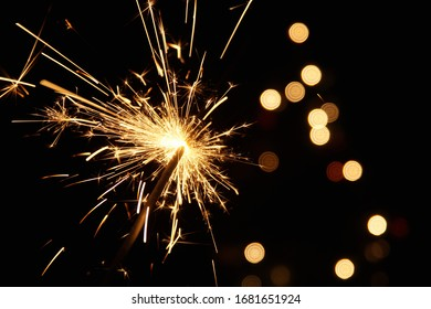 burning sparkler firework. Happy new year and Merry christmas concept. Happy holidays. Abstract blurred of Sparklers for celebration. Magic light. Winter Xmas decoration. Realistic light effect.