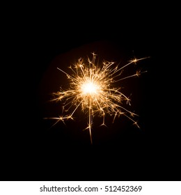 Burning sparkler isolated on black background