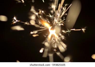 Burning sparkler isolated on black background in darkness