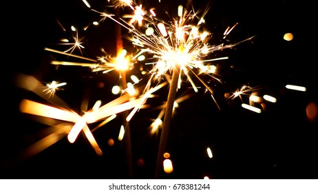 Burning Sparklers in blurred motion. Christmas New Year and Independence Day celebration lights.