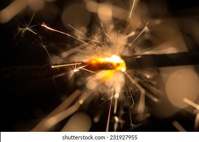 Burning sparklers isolated on black background