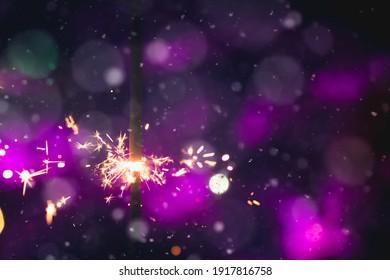 BURNING SPARKLING LIGHT ON DARK BOKEH BACKGROUND, FESTIVE PATTERN, CELEBRATION DESIGN