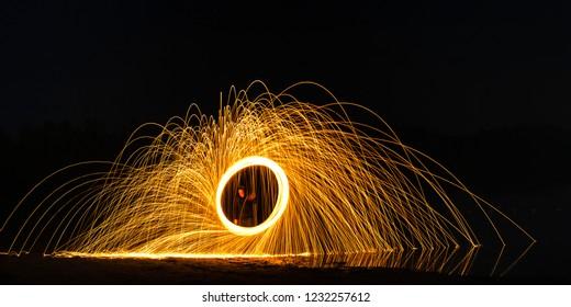 Burning Steelwool Clockwise Beach Pat Framed