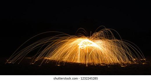Burning Steelwool Umbrella Spiral