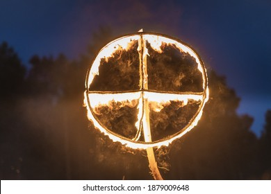 Burning symbol of the sun, a sun cross or solar wheel at pagan reenactment of Kupala Night, called in Poland Noc Kupaly. Slavic holiday celebrated on the shortest night of the year, summer solstice - Shutterstock ID 1879009648