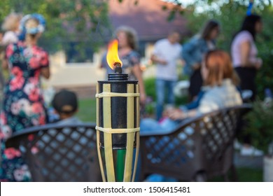 Burning torch in front of house party