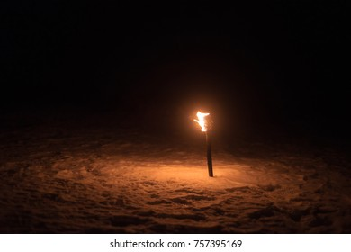 burning torch lights up the winter night fire alone dark lonely background nature mystical wallpaper