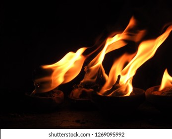 Burning torch rising fire, Beautiful yellow (gold) flame background
