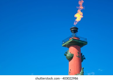 Burning torch Rostral columns in St. Petersburg on victory day closeup, tourist attraction, tourist sight