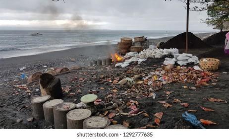 Burning trash on the Kusamba beach in Bali
