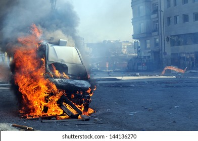 Burning van with large flames and black smoke