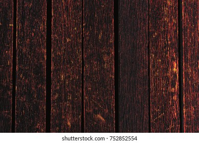Burning wood background texture. Material and wallpaper concept