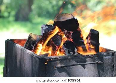 Burning wood in a brazier in the garden