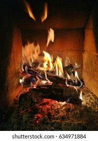 Burning wood in fire place