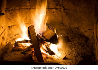 burning wood in a fireplace close up