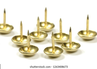 Burnished Brass Upholstery Tacks, French Natural Round Furniture Nails. Shiny Golden Yellow Style. Large Detailed Isolated Macro Closeup Studio Shot, Gentle Bokeh Shadows