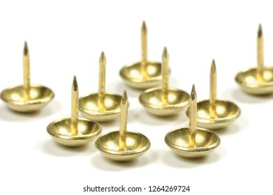 Burnished Brass Upholstery Tacks, French Natural Round Furniture Nails, Shiny Golden Yellow Style, Large Detailed Isolated Macro Closeup Studio Shot, Gentle Bokeh Shadows