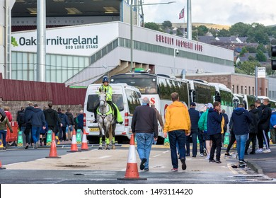 Burnley, Lancashire England UK - August 31, 2019, Volunteers and mounted police officer on crowd control duty and football supporters arriving at football match between FC Burnley and FC Liverpool out