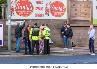 Burnley, Lancashire England UK - August 31, 2019 Police officers and football supporters on the street outside a Turf Moor before a match between Fc Burnley and Fc Liverpool in Barclays Premier League