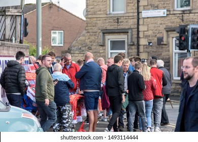 Burnley, Lancashire England UK - August 31, 2019, Football supporters arriving at football match between FC Burnley and FC Liverpool on busy street outside a Turf Moor