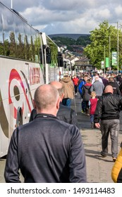 Burnley, Lancashire England UK - August 31, 2019, Football supporters arriving at football match between FC Burnley and FC Liverpool outside a Turf Moor and bus couches parked along the street