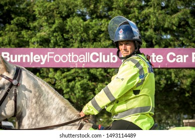Burnley, Lancashire England UK - August 31, 2019, Mounted police officer on crowd control duty at football match between FC Burnley and FC Liverpool outside a Turf Moor