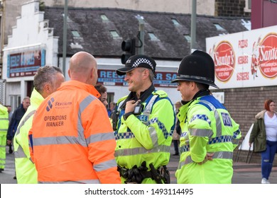 Burnley, Lancashire England UK - August 31, 2019, Police officers on crowd control duty  at football match between FC Burnley and FC Liverpool outside a Turf Moor