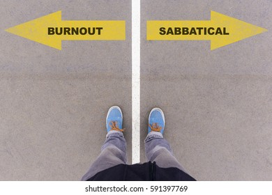 Burnout or sabbatical choice, text on asphalt ground, feet and shoes on floor, personal perspective footsie concept