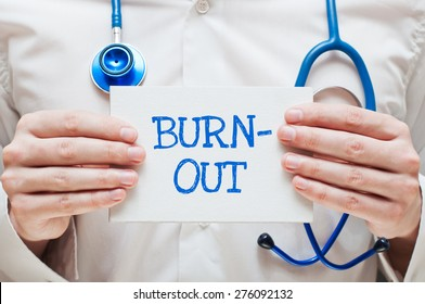Burnout Written on a Card in Hands of Medical Doctor