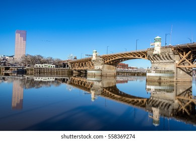 Burnside bridge beautifully reflected in the Willamette River in Portland, Oregon