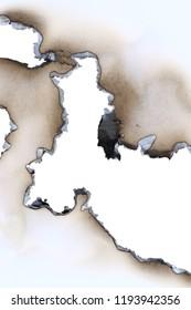 Burnt all through blank sheet of a paper - detail