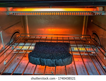 burnt bread on the electric oven grill. bread toast burned in the electric oven.