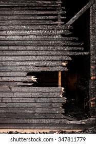 Burnt broken wood wall background texture