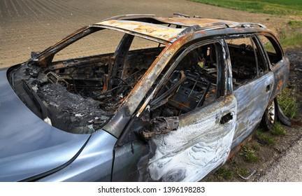 Burnt car at road side