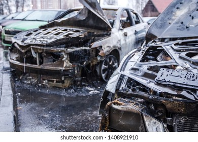 Burnt cars in city. Arson cars in the parking lot. Insured accident