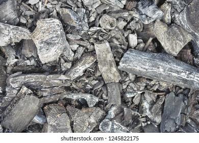 Burnt coals cooled down, top view. Burnt coals cooled down, top view. Gray natural textural background.