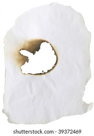 burnt hole in old paper isolated on white