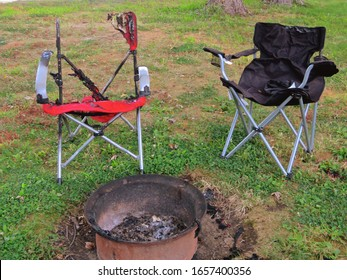 Burnt lawn chairs by an extinguished campfire.