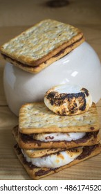 burnt marshmallow put smores pile