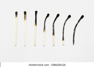 burnt matches on white background