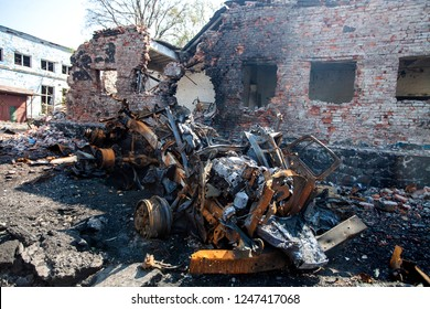 burnt military machinery in the background of the house split the pieces, War actions aftermath, Ukraine and Donbass conflict