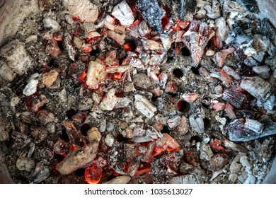Burnt natural charcoal used in cooking stove for food. Thailand, Asia