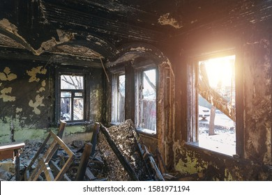 Burnt old rural house interior. Consequences of fire