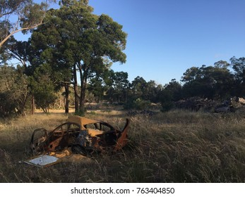 Burnt out car remains against a backdrop of Australian bush in Wellard, outside of Perth.