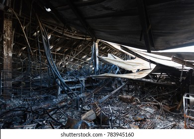 Burnt out Factory with charred roof trusses After Fire in Perfume Factory / Burnt interiors of factory after fire.