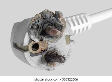 a burnt power plug in grey back