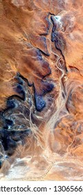 the burnt skin, tribute to Pollock, vertical abstract photography of the deserts of Africa from the air, aerial view, abstract expressionism, contemporary photographic art, abstract naturalism,