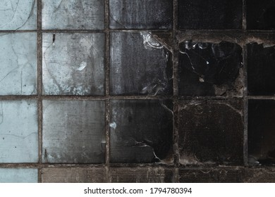 Burnt tiled wall in an old abandoned building. destroyed surface. grunge background