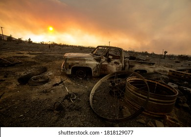 A burnt vehicle is seen during the Bobcat Fire burning in Juniper Hills, California, Saturday, Sept. 19, 2020.
