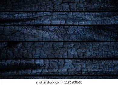 Burnt wooden Board texture. Burned scratched hardwood surface. Smoking wood plank halloween background